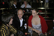 Roger Saul, Catherine Bailey, , Bazaar and Moet  Black, White and Gold party. Ronnie Scott's. Frith St. London. 16 november 2006. ONE TIME USE ONLY - DO NOT ARCHIVE  © Copyright Photograph by Dafydd Jones 66 Stockwell Park Rd. London SW9 0DA Tel 020 7733 0108 www.dafjones.com