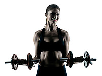one caucasian woman exercising fitness body building exercises in studio in silhouette isolated