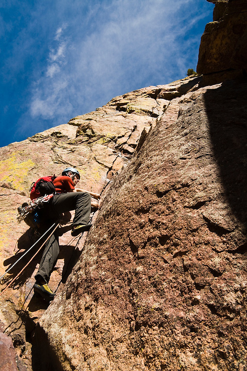Obadiah Reid lead climbs the first pitch of Icarus (5.6) on Redgarden Wall, Eldorado Canyon State Park, Colorado.