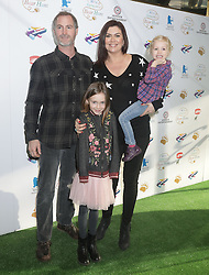 Amanda Lamb with her husband Sean McGuinness and their children Willow (bottom) and Charlotte attending a screening of We're Going on a Bear Hunt at the Empire Leicester Square in central London.