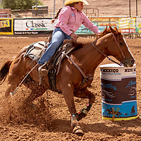 Photo: Jeffery Jones<br /> Amanda Kanapilly rides her horse around a barrel Saturday during the New Mexico High School Rodeo Association State Finals at Red Rock Park.