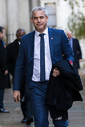 © Licensed to London News Pictures. 10/11/2019. London, UK. Brexit Secretary, Stephen Barclay walks through Downing Street to attend the Remembrance Sunday Ceremony at the Cenotaph in Whitehall. Remembrance Sunday events are held across the country today as the UK remembers and honours those who have sacrificed themselves in two world wars and other conflicts. Photo credit: Vickie Flores/LNP