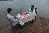 Two customers have meal on a floating restaurant