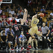 UCF Knights forward Kasey Wilson (32) shoots over Louisville Cardinals forward Stephan Van Treese (44) during an NCAA basketball game between the 14th ranked Louisville Cardinals and the UCF Knights at the CFE Arena on Tuesday, December 31, 2013 in Orlando, Florida. (AP Photo/Alex Menendez)