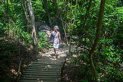 Santa Marta, Colombia - 4/29/2017 - A woman walking in the Tayrona Park, Santa Marta(Photo by Daniel Garzon/VWPics) *** Please Use Credit from Credit Field *** *** Please Use Credit from Credit Field ***