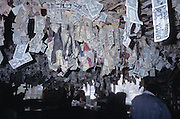 American money hanging from bar ceiling