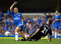 Photograph: Scott Heavey.<br />Chelsea v Leicester City, from Stamford Bridge. 23/08/2003.<br />Riccardo Scimeca fouls Joe Cole to earn him a second yellow.
