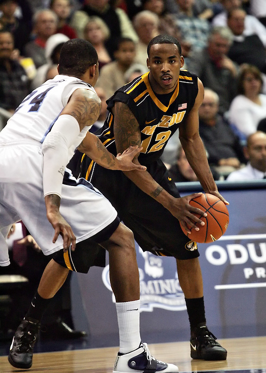 Dec 30, 2011; Norfolk, VA, USA; Missouri Tigers guard Marcus Denmon (12) is defended by Old Dominion Monarchs guard/forward Kent Bazemore (24) at the Ted Constant Convocation Center. Mandatory Credit: Peter Casey-US PRESSWIRE