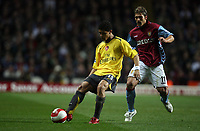 Photo: Rich Eaton.<br /> <br /> Aston Villa v Arsenal. The Barclays Premiership. 14/03/2007. Denilson left of Arsenal shields the ball from Aston Villas Stiliyan Petrov