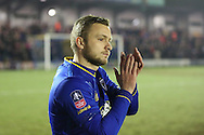 AFC Wimbledon midfielder Dean Parrett (18) clapping during the The FA Cup third round replay match between AFC Wimbledon and Sutton United at the Cherry Red Records Stadium, Kingston, England on 17 January 2017. Photo by Matthew Redman.