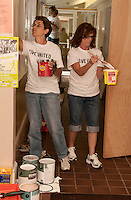 """Chris Northup and Nancy Walker from LRGHeathcare and Tamara Valenten from Meredith Village Savings Bank participate in the United Way's """"Day of Caring"""" by giving the walls a fresh coat of paint at the Genesis Behavioral Health Center in Laconia on Friday morning.  (Karen Bobotas/for the Laconia Daily Sun)"""
