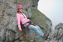 Girl resting exhausted climbing helmet mountains