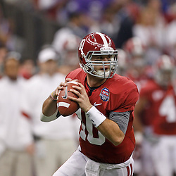 Jan 9, 2012; New Orleans, LA, USA; Alabama Crimson Tide quarterback AJ McCarron (10) against the LSU Tigers during the first half of the 2012 BCS National Championship game at the Mercedes-Benz Superdome.  Mandatory Credit: Derick E. Hingle-US PRESSWIRE
