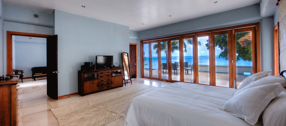 Hotel Bedroom Interior with View of Ocean and Private Patio, Fiji