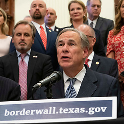 Texas leaders including Gov. GREG ABBOTT (c) and Lt. Gov. DAM PATRICK (l) announce a campaign to build a southern border wall with Mexico using a combination of state and privately donated funds. Abbott voiced frustration with President Biden's stopping wall construction which he says has resulted in exploding migration numbers at the border.