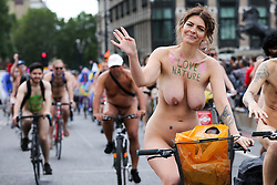 © Licensed to London News Pictures. 08/06/2019. London, UK. Nude cyclists take part in the 16th annual naked bike ride by riding bicycles on Westminster Bridge as part of the World Naked Bike Ride (WNBR) event. The riders demonstrates the vulnerability of cyclists and protests against car culture by raising awareness of cyclists on the roads.<br /> <br /> *** Warning - Nudity *** <br /> <br /> Photo credit: Dinendra Haria/LNP