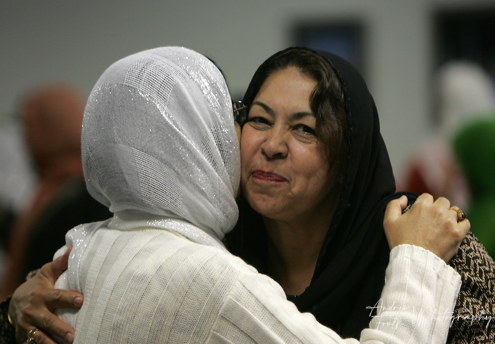 /Andrew Foulk/For The Californian/.Auela Yaqubi, hugs a fellow worshiper at the Islamic Center of Temecula Sunday morning after the end of services for the final day of Ramadan.