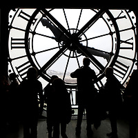 Europe, France, Paris. Clock and silouettes at Musee D'Orsay.