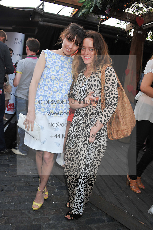 Left to right, SHEHERAZADE GOLDSMITH and ALICE TEMPERLEY at Tunnel of Love - a fashion & art party in aid of The British Heart Foundation held at The Proud Gallery, Camden, London on 29th May 2012.