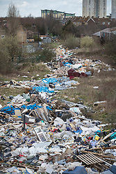 © Licensed to London News Pictures. 29/03/2018. London, UK. A large pile of waste and rubbish has been dumped in an area of scrap land next to houses and a recreation park in Edmonton, north London. Local residents are calling it a 'river of rubbish' and say it has been there for a month and are campaigning for it's removal.  Photo credit: Peter Macdiarmid/LNP