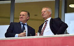 QPR club ambassador Andy Sinton (left) and Bristol City Steve Lansdown in the stands