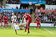 Kyle Naughton of Swansea city has an acrobatic shot at goal blocked by Richarlison of Watford (11).  Premier league match, Swansea city v Watford at the Liberty Stadium in Swansea, South Wales on Saturday 23rd September 2017.<br /> pic by  Andrew Orchard, Andrew Orchard sports photography.