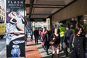 London shoppers and commuters walking past House of Fraser on Victoria Street, London, United Kingdom.