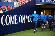 Led by Tottenham Hotspur forward Harry Kane (10), Tottenham Hotspur players come out to start their warm up during the Premier League match between Tottenham Hotspur and West Bromwich Albion at Wembley Stadium, London, England on 25 November 2017. Photo by Andy Walter.