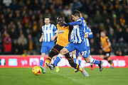 Hull City midfielder Mohammed Diame (17) and Brighton striker, Anthony Knockaert (27) during the Sky Bet Championship match between Hull City and Brighton and Hove Albion at the KC Stadium, Kingston upon Hull, England on 16 February 2016.