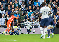 Football - 2019 / 2020 Premier League - Tottenham Hotspur vs. Watford<br /> <br /> Dele Alli (Tottenham FC) pounces on the mistake after Ben Foster (Watford FC)  and Kiko Femenía (Watford FC) collide to score the equaliser at The Tottenham Hotspur Stadium.<br /> <br /> COLORSPORT/DANIEL BEARHAM