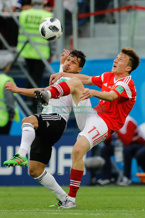 June 19, 2018 - Saint Petersburg, Russia - Aleksandr Golovin (R) of Russia national team and Tarek Hamed of Egypt national team vie for the ball during the 2018 FIFA World Cup Russia group A match between Russia and Egypt on June 19, 2018 at Saint Petersburg Stadium in Saint Petersburg, Russia. (Credit Image: © Mike Kireev/NurPhoto via ZUMA Press)