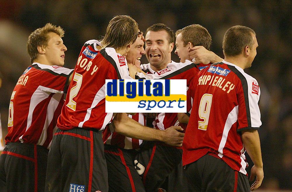 Photo: Aidan Ellis.<br /> Sheffield Utd v Luton Town. Coca Cola Championship.<br /> 01/11/2005.<br /> Sheffield's Chris Morgan celebrates his goal with team mates David Unsworth and Alan Quinn
