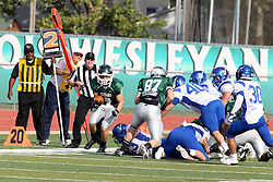 12 October 2013:   Alex Garvey picks up and advances a ball fumbled by Sean Conley during an NCAA division 3 football game between the North Park vikings and the Illinois Wesleyan Titans in Tucci Stadium on Wilder Field, Bloomington IL