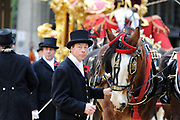 Footmen prepare the horse drawn coach for the newly appointed Lord Mayor of the City of London Michael Bear during the traditional  Lord Mayor's parade through London.