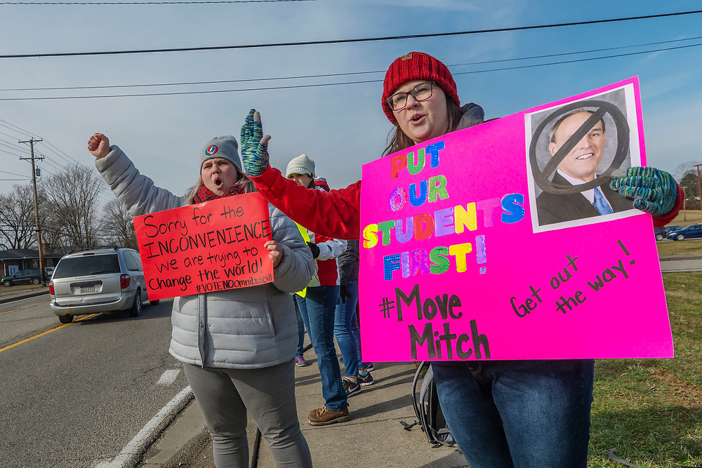 """Cabell County schoolteachers Ginny Noble, right, and Kayla Massie demonstrate outside of Hurricane High School in Putnam County, W.Va, during the first day of a statewide strike by teachers and school personnel on Tuesday, February 19, 2019. While the other 54 state counties have decided to close schools, Putnam county has decided to keep its schools open. The strike was announced the night before by union leaders of the WVEA, AFT-WV and WVSSPA shortly before the state Senate amended and passed an amended version of Senate Bill 451 passed by the House of Delegates; reinstating provisions on allowing charter schools and downplaying the role of seniority among other measures that unions oppose. When asked how long the strike will last, the union leaders said the decision will be made """"day by day."""""""