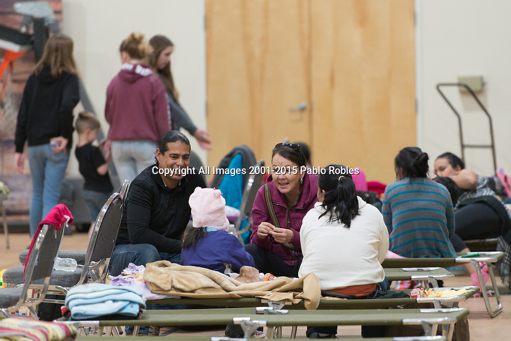 Jose Noriega and Jackelyn Badine volunteers at the First Southern Baptist Church of Avondale,  help refugees at the church after being dropped off by ICE on December 27, 2018.