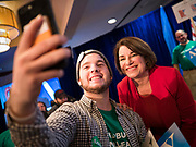 03 FEBRUARY 2020 - DES MOINES, IOWA: US Senator AMY KLOBUCHAR (D-MN) poses for a selfie during her caucus night party at the downtown Marriott Hotel in Des Moines. The party was her last Iowa appearance of the primary season. Iowans made the first presidential selection picks of the 2020 election campaign with the Iowa caucuses Monday night.   PHOTO BY JACK KURTZ