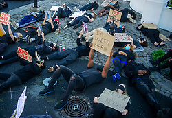 South Africa - Cape Town - 30 June 2020 - A Gender Based Violence protest was held outside of parliament today. A large group of mostly women, wearing black and holding placards denouncing violence against women stood in solidarity. Picture Courtney Africa/African News Agency(ANA)