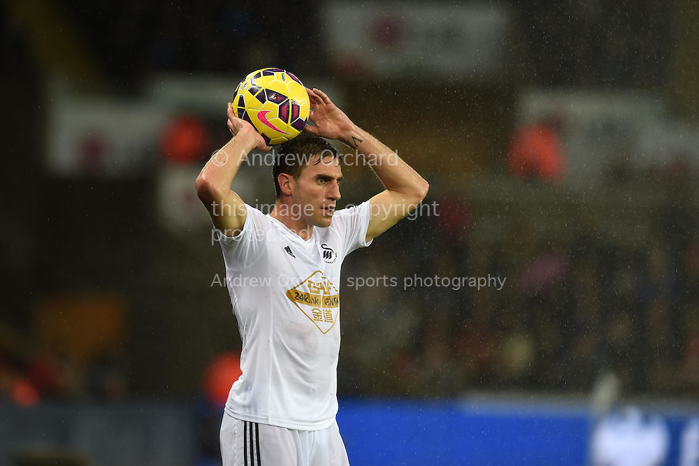 Angel Rangel of Swansea city in action.Barclays Premier league match, Swansea city v Aston Villa at the Liberty stadium in Swansea, South Wales on Boxing Day, Friday 26th December 2014<br /> pic by Andrew Orchard, Andrew Orchard sports photography.