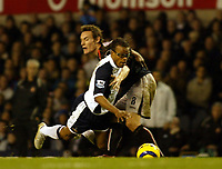 Photo: Chris Ratcliffe.<br />Tottenham Hotspur v Sunderland. The Barclays Premiership. 03/12/2005.<br />Edgar Davids (R) goes down under a challenge from Dean Whitehead