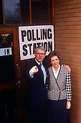 John Major poses outside his constituency polling station with wife Norma, seeking re-election after replacing Margaret Thatcher. Major won this election, continuing in office until his landslide defeat by Labour's Tony Blair in 1997. Major (born 29 March 1943) is a British Conservative politician who served as Prime Minister of the United Kingdom and Leader of the Conservative Party from 1990–1997. He held the posts of Foreign Secretary and Chancellor of the Exchequer in the cabinet of Margaret Thatcher and was MP for Huntingdon 1979–2001.