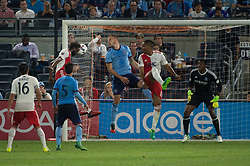 May 31, 2017 - New England Revolution midfielder LAGLAIS KOUASSI (12) heads win the tying goal while New York City FC defender FREDERIC BRILLANT (13) and New York City FC midfielder MIKEY LOPEZ (5) look on during regular season play at Yankee Stadium in Bronx, NY. (Credit Image: © Mark Smith via ZUMA Wire)