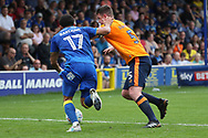 AFC Wimbledon striker Andy Barcham (17) taking on Oldham Athletic defender Anthony Gerrard (5) during the EFL Sky Bet League 1 match between AFC Wimbledon and Oldham Athletic at the Cherry Red Records Stadium, Kingston, England on 21 April 2018. Picture by Matthew Redman.