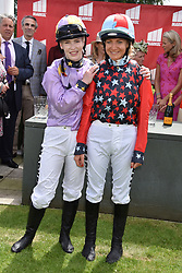 29 July 2021 - The QATAR Goodwood Festival Ladies Day at Goodwood Racecourse, West Sussex.<br /> Picture Shows - Joint winners of the Magnolia Cup Thea Gosden Hood and Candida Crawford.<br /> <br /> NON EXCLUSIVE - WORLD RIGHTS