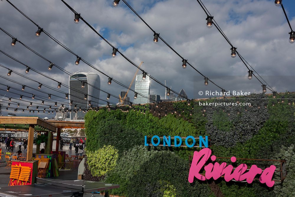 A themed cafe promoting the capital as a Riviera, with a background panorama looking north from More London in Southwark, towards the City of London.