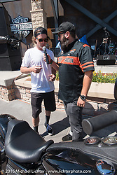 Jesse Rooke with MC Dano Legere at the Harley-Davidson Rally Point Plaza during the Annual Sturgis Black Hills Motorcycle Rally.  SD, USA.  August 7, 2016.  Photography ©2016 Michael Lichter.