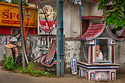 Mother Teresa shrine in front of a fried chicken shop on 28th February 2018 in Kochi, Kerala, India. She spent many years in Calcutta, India where she founded the Missionaries of Charity, a religious congregation devoted to helping those in great need.