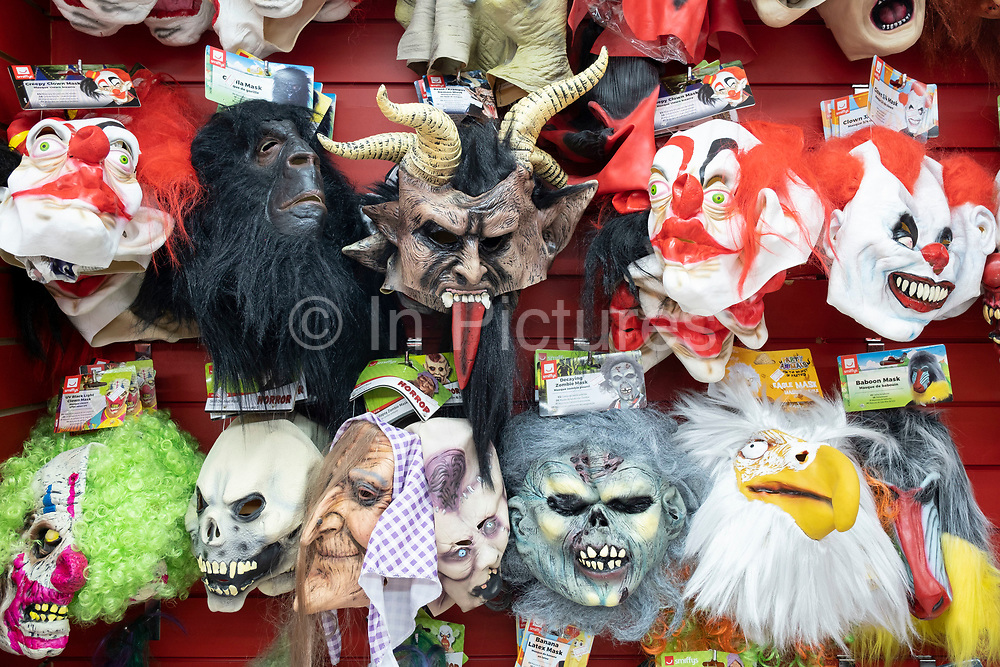 Goulish face masks of horror or scary characters for sale on 13th August 2020 in London, United Kingdom. Evil looking clowns and monster faces designed to scare people have mostly originated from horror films and from comc books.