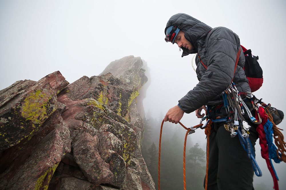 Obadiah Reid manages the rope on a climb of the First Flatiron (Direct East Face, 5.6) above Boulder, Colorado.