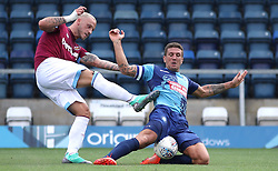 West Ham United's Marko Arnautovic is challenged by Wycombe Wanderers Adam El-Abd during a pre-season match at Adams Park, Wycombe.